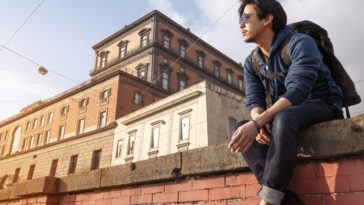 Asian backpacker man traveling in Italy, Europe